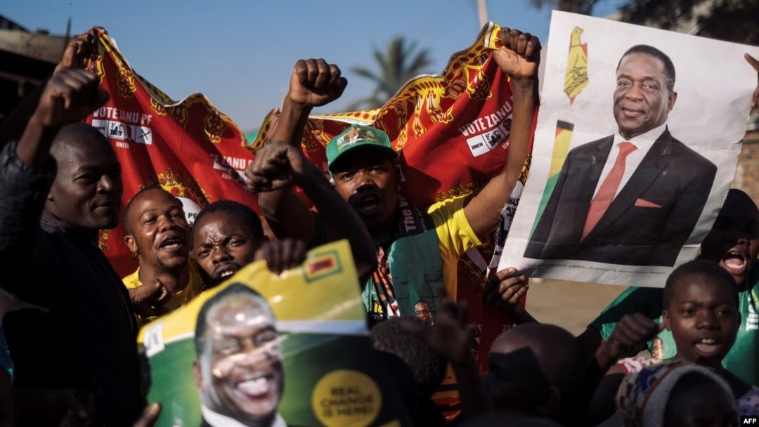Supporters of the newly elected Zimbabwe President Emmerson Mnangagwa celebrate in Mbare, Harare, Aug. 3, 2018.