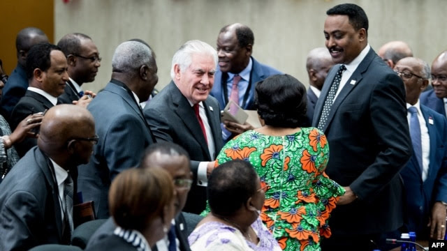 U.S. Secretary of State Rex Tillerson greets participants during a meeting of African leaders at the State Department in Washington, Nov. 17, 2017.