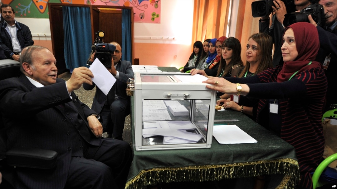 FILE - Algerian President Abdelaziz Bouteflika casts his ballot to vote in Algiers,May 4, 2017.