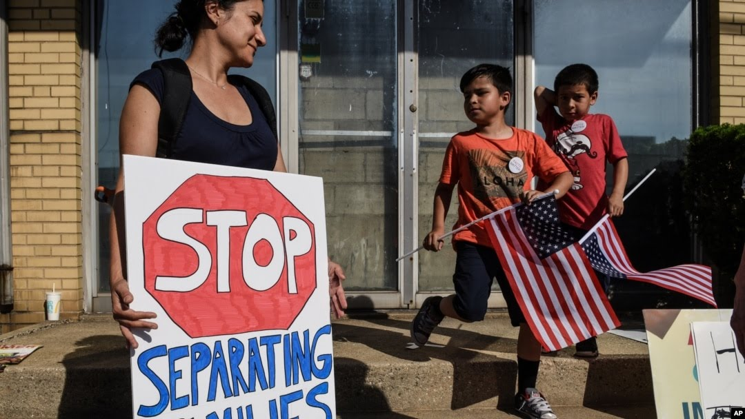 People participate in a protest against recent U.S. immigration policy that separates children from their families when they enter the U.S. as undocumented immigrants, in front of a Homeland Security facility in Elizabeth, New Jersey, June 17, 2018.