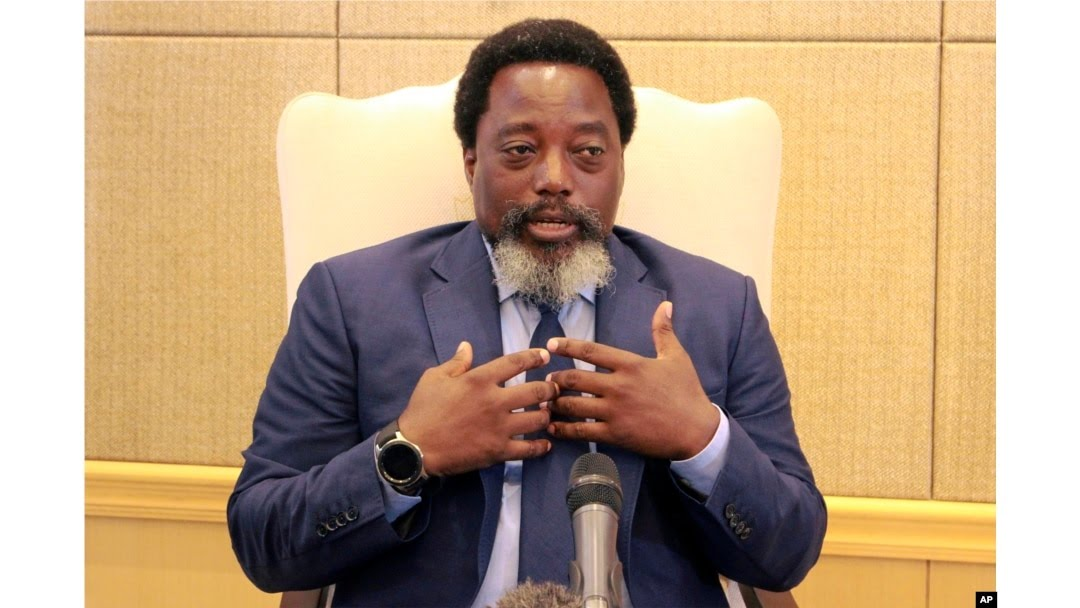 FILE - Democratic Republic of Congo's President Joseph Kabila speaks during an interview by the Associated Press at the Nation's Palace in Kinshasa, Dec. 9, 2018.